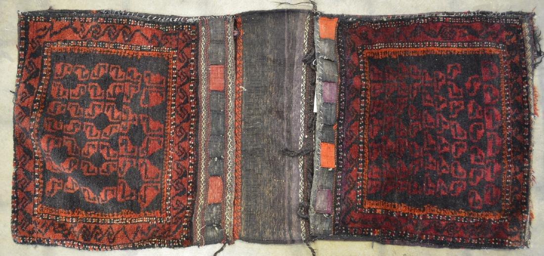 "Oriental tribal saddle blanket, 56""L x 24""W. Sides of"