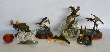 Grouping of 7 modern composition wildlife sculptures by
