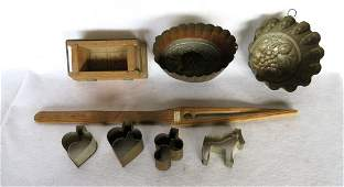 Grouping of 7 early tin and wood molds including 4 tin
