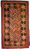 Folk art hooked rug, professionally mounted, having a