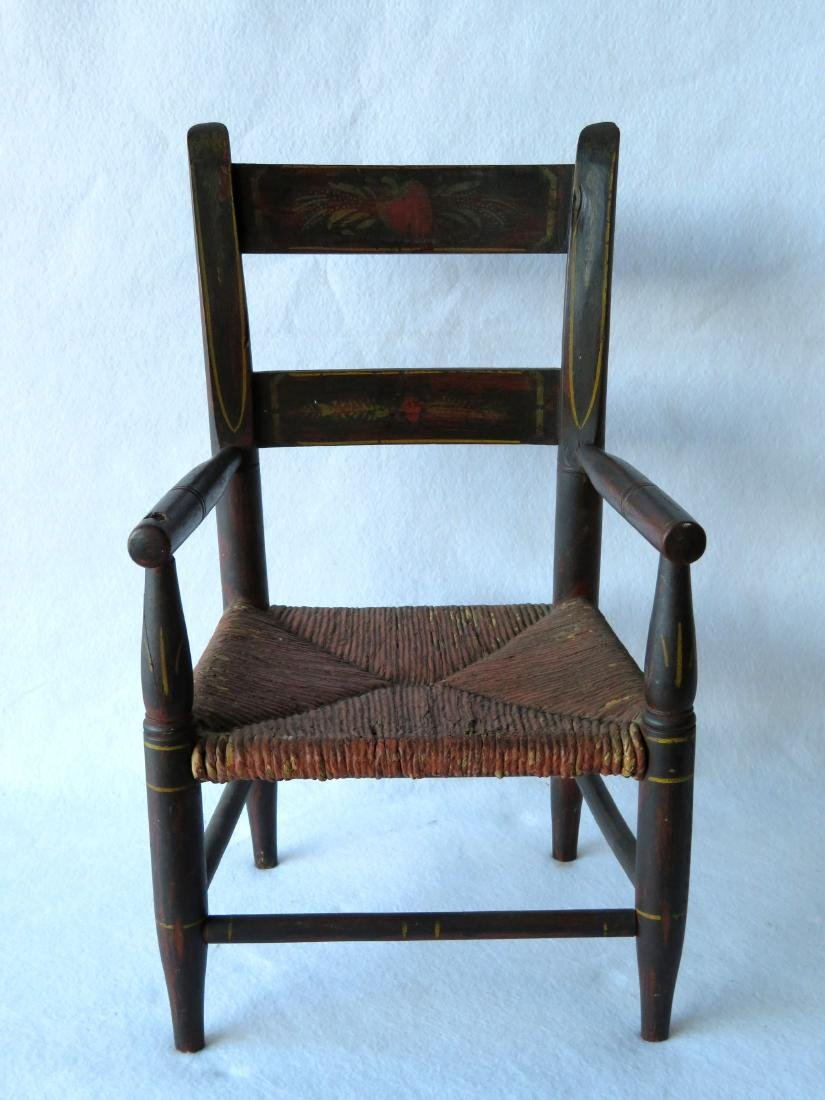 Early grain painted child's arm chair with yellow pin