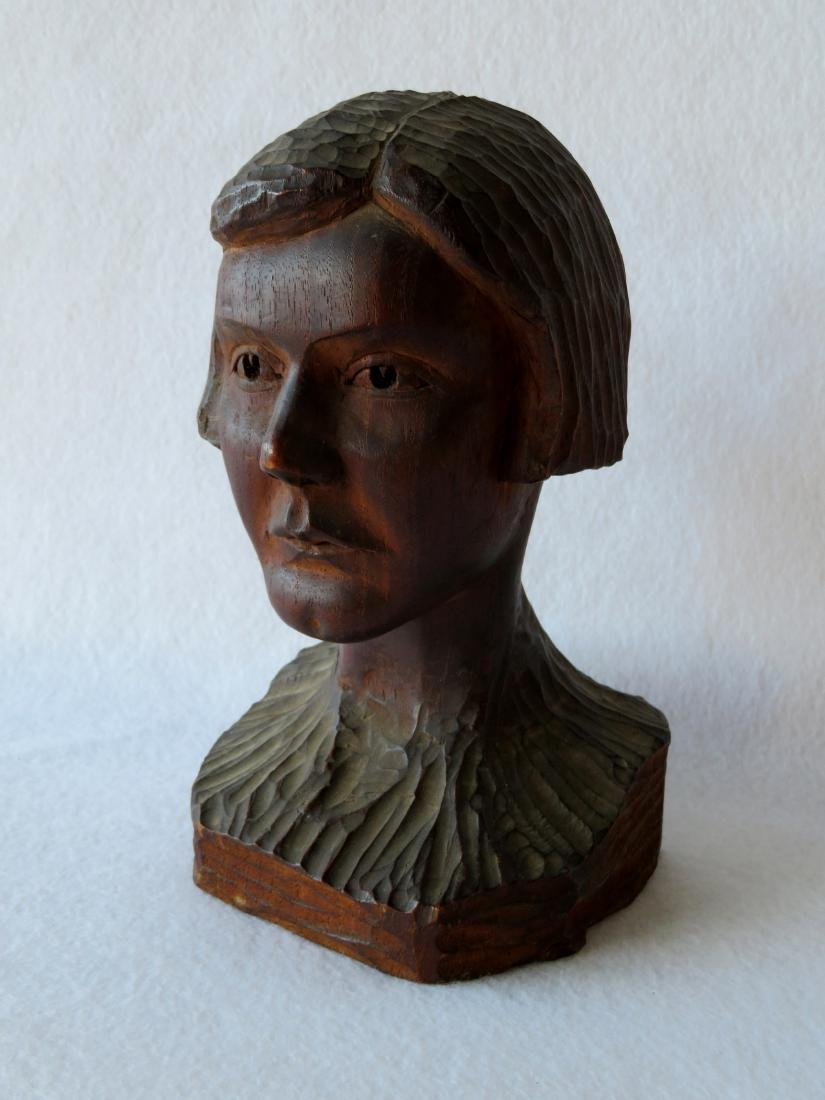 Carved wooden bust of a young person with short hair -