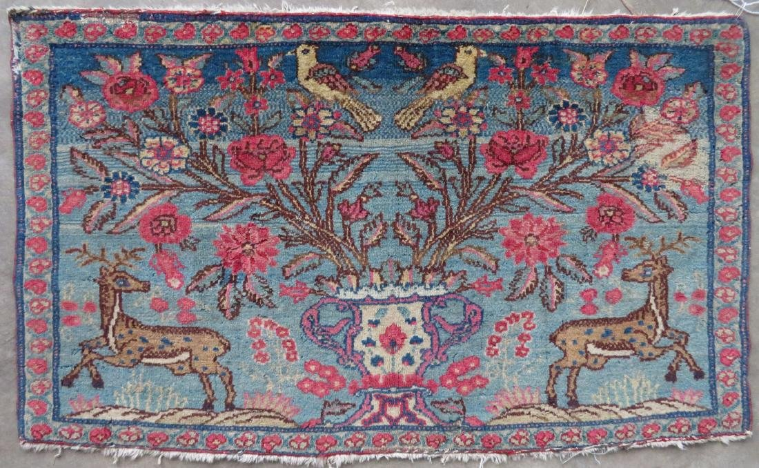 Small pictorial oriental rug decorated with a central