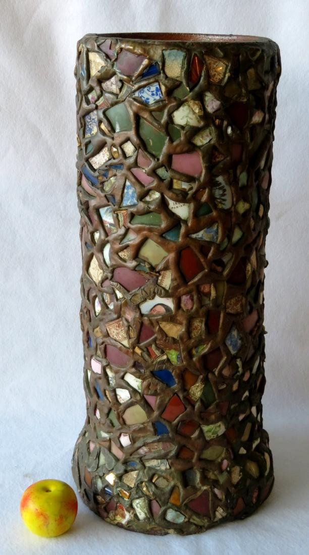 Folkart sewer tile art creation in the form of an