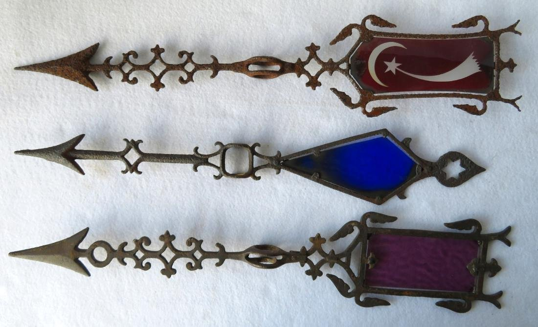 Three lighting rod arrows including: 1) Rippled