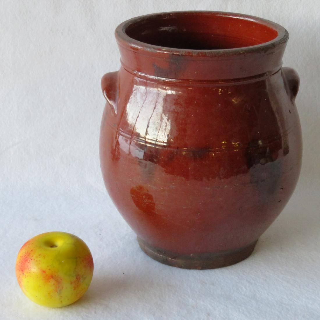 Redware ovoid storage jar with handles and manganese