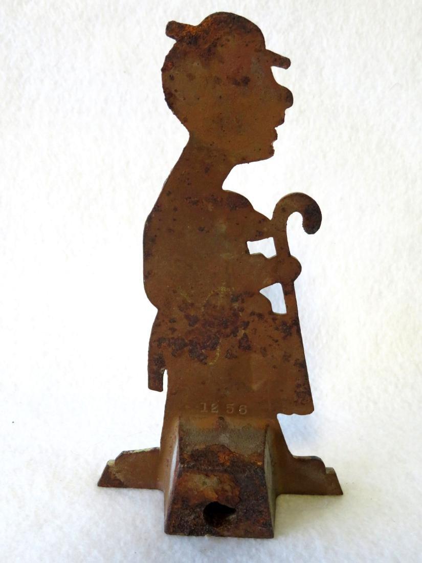 Dapper Dan cast iron figural door stop in original - 2