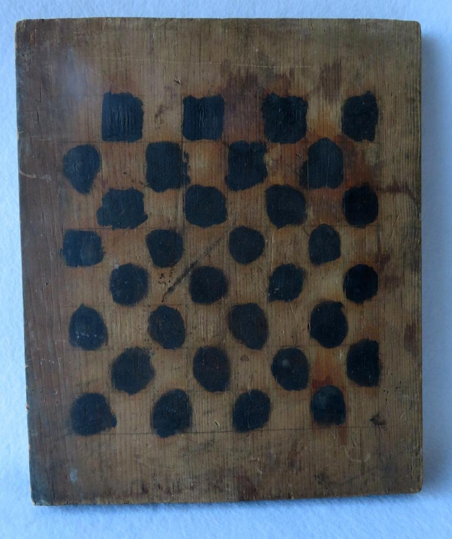 Very primitive naïve game board with black painted