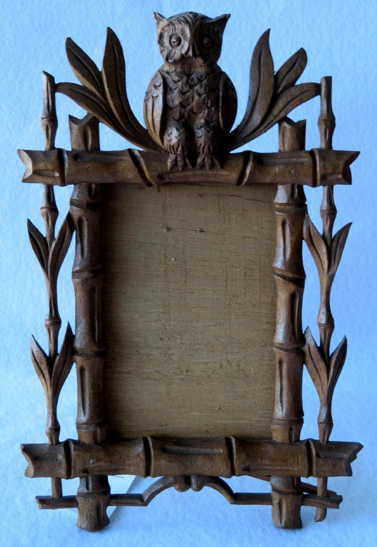 Rustic carved wooden frame with a seated owl finial, - 2