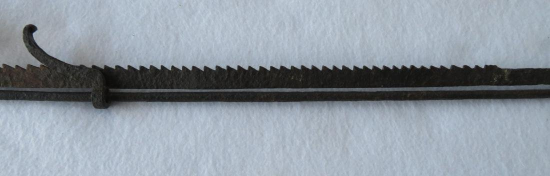 Ratchet form loom light in hand forged iron. Longest - 5