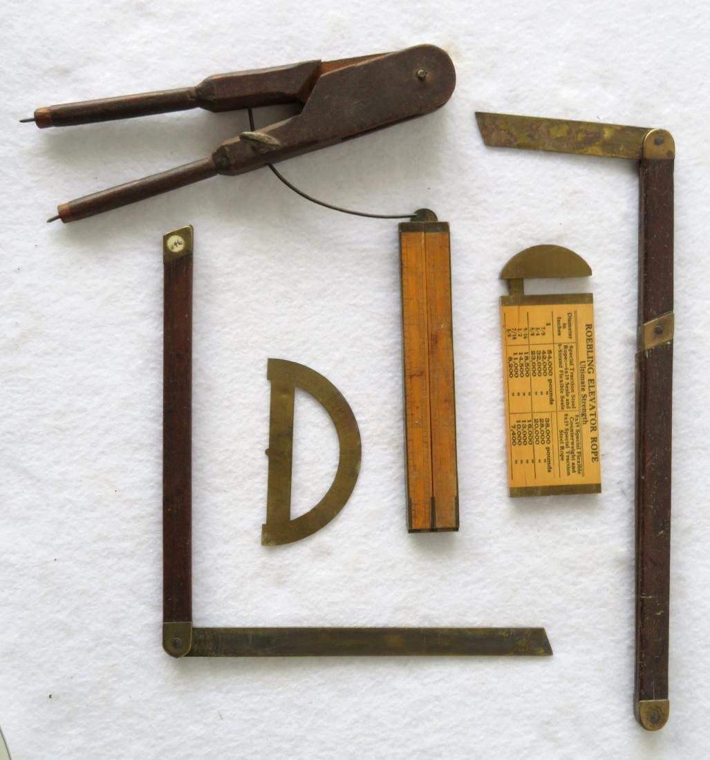 Six vintage measuring devices including a primitive