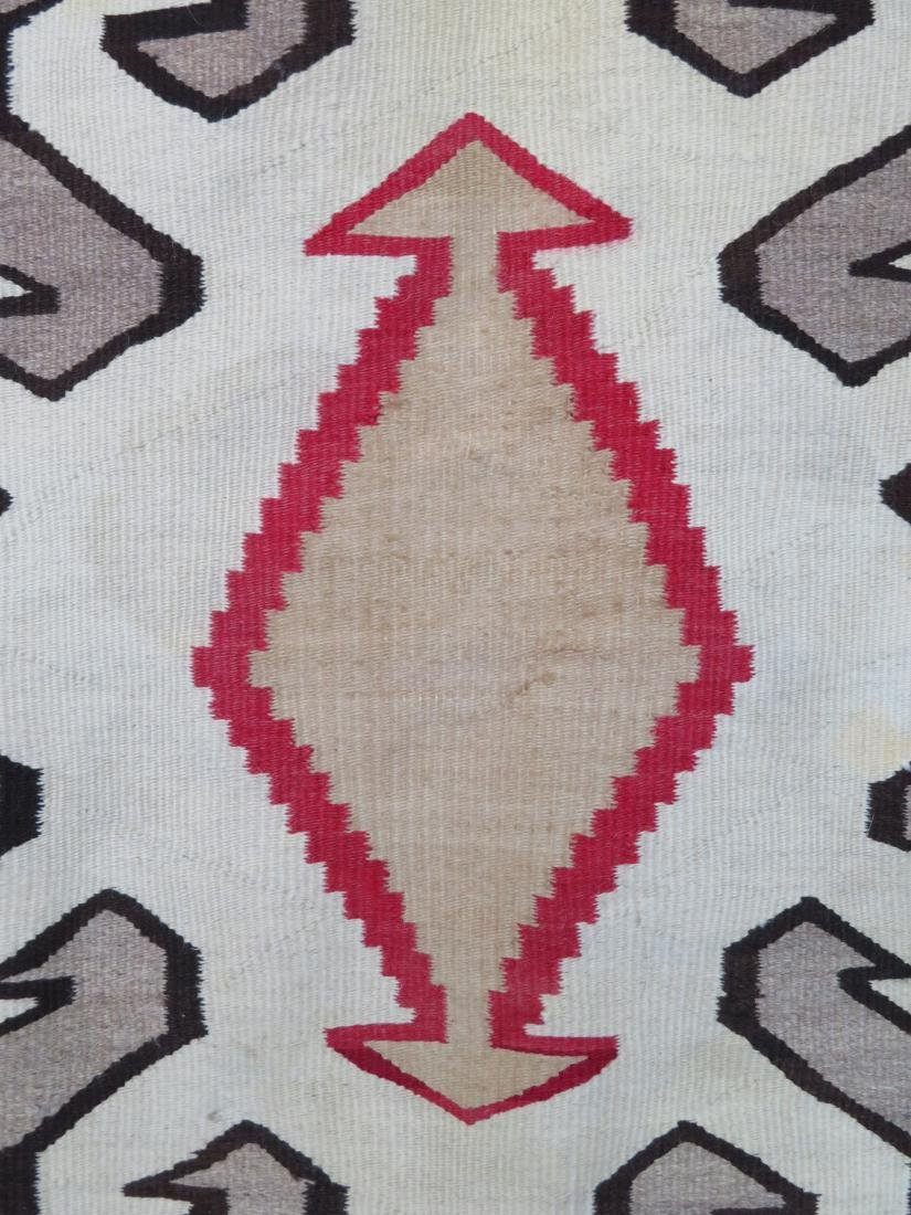 "Large Navajo rug in mostly earth tone colors - 4' 9"" x - 10"