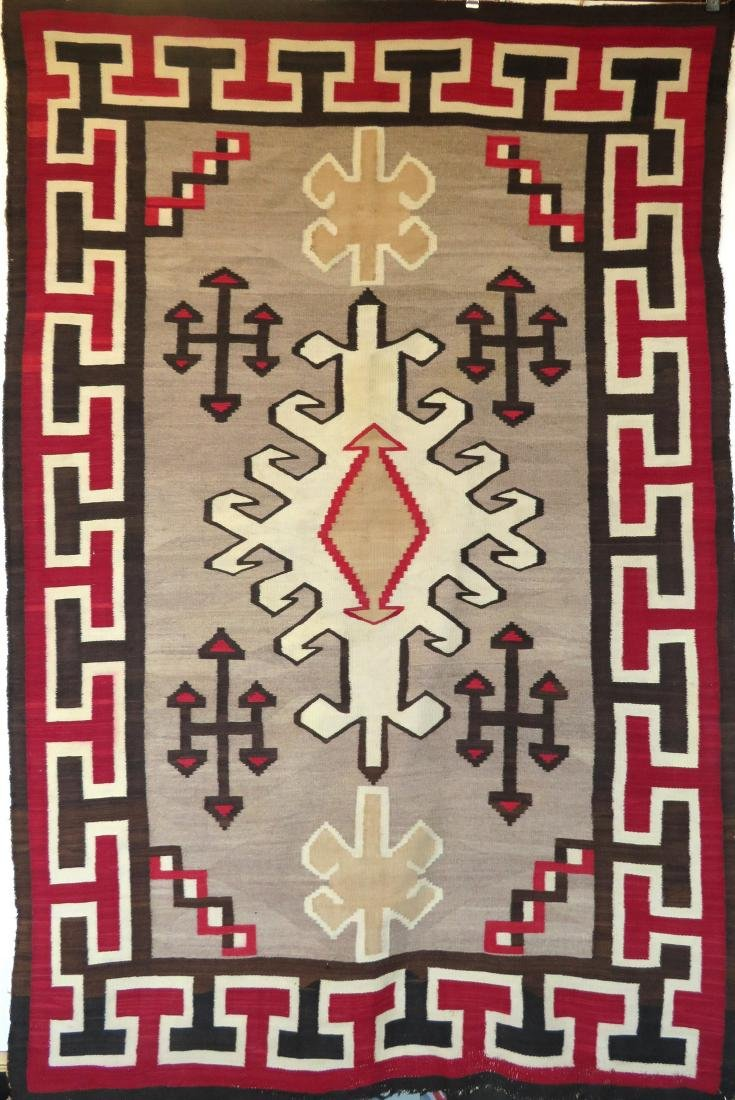 "Large Navajo rug in mostly earth tone colors - 4' 9"" x"