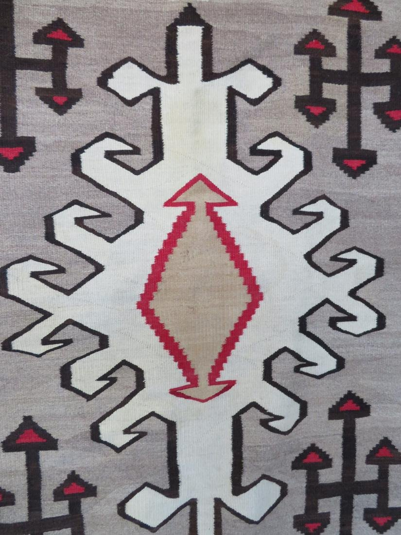 "Large Navajo rug in mostly earth tone colors - 4' 9"" x - 2"