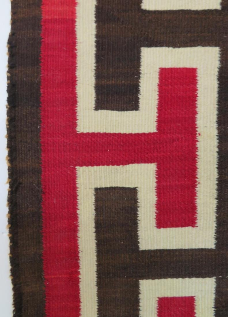 "Large Navajo rug in mostly earth tone colors - 4' 9"" x - 4"