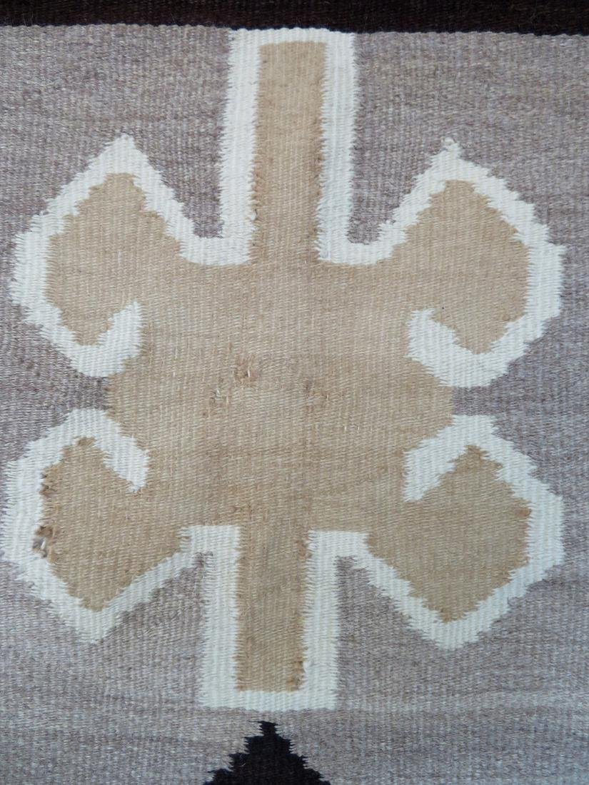 "Large Navajo rug in mostly earth tone colors - 4' 9"" x - 7"