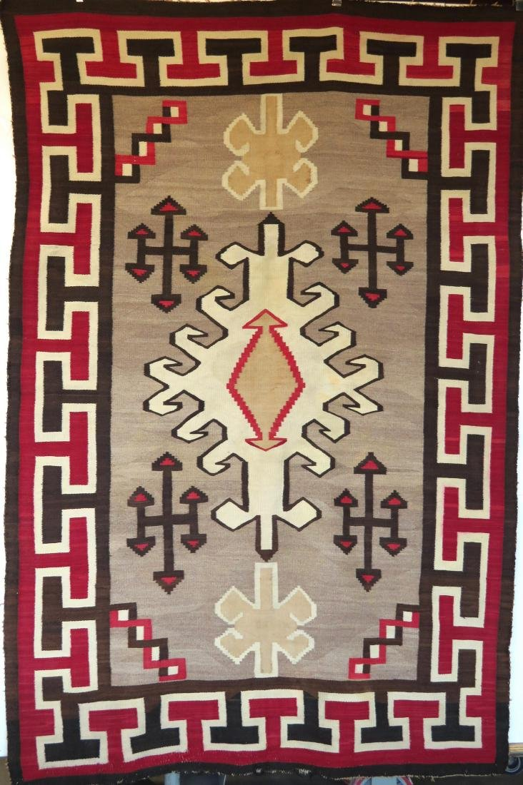 "Large Navajo rug in mostly earth tone colors - 4' 9"" x - 9"
