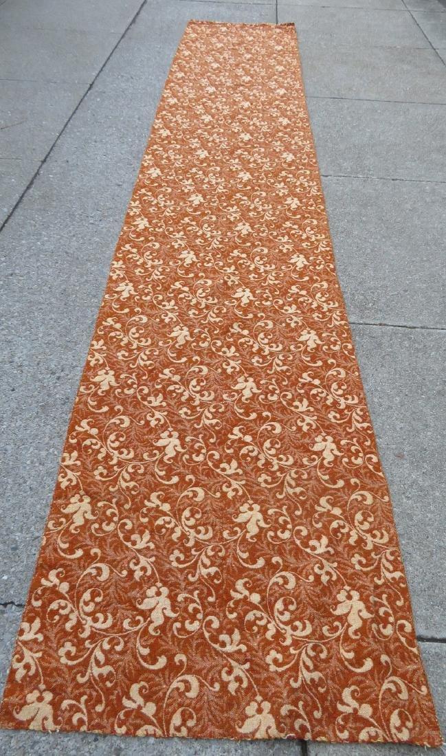A large homespun ingrain carpet in earth tone colors,
