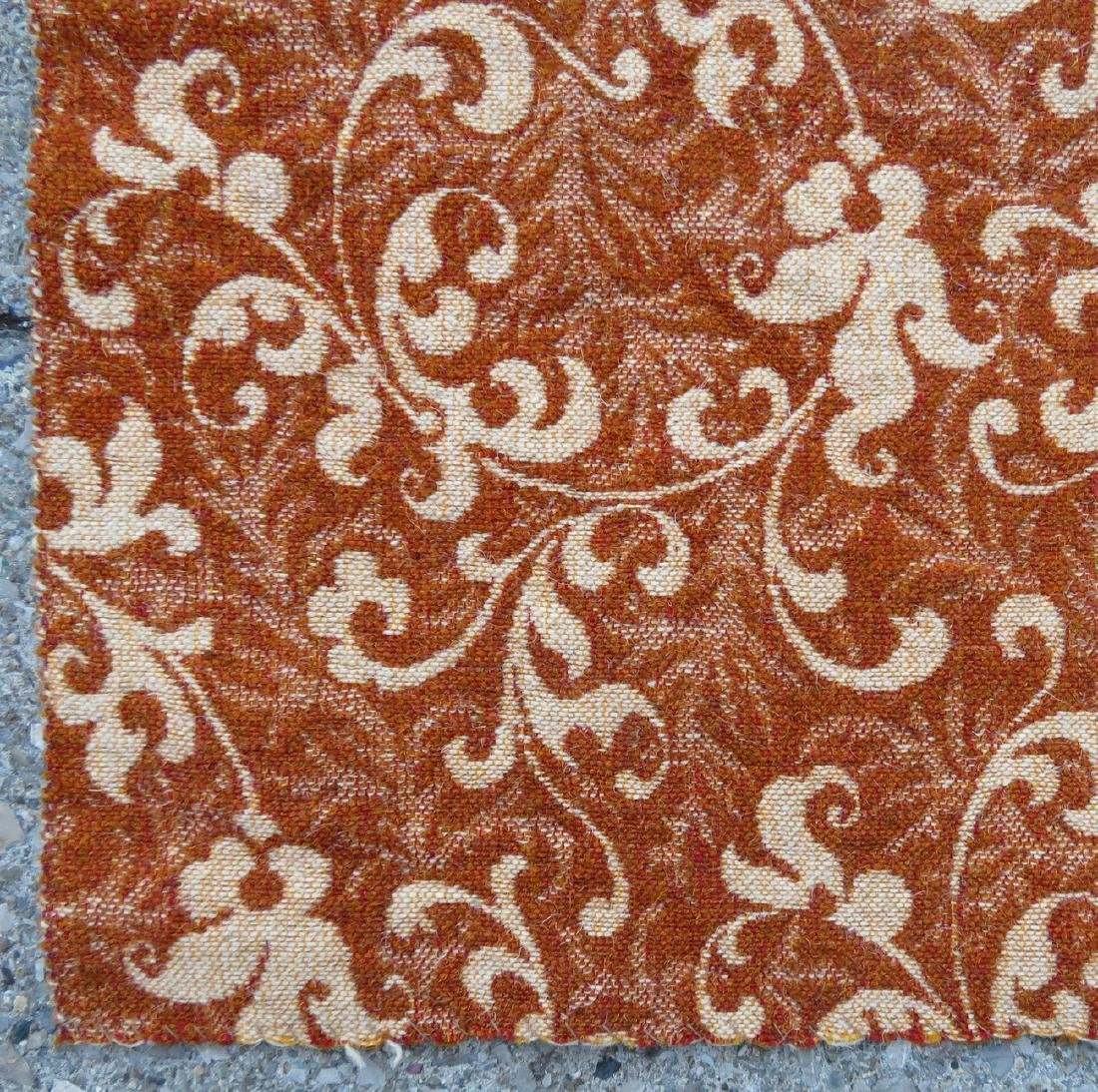 A large homespun ingrain carpet in earth tone colors, - 2
