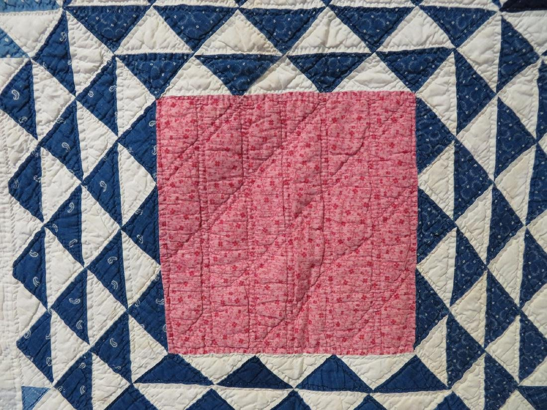 Patchwork quilt with blue flying geese surrounding pink - 2