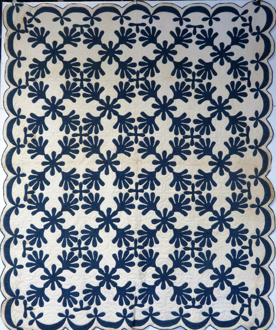 Hudson Valley blue and white applique quilt in the oak