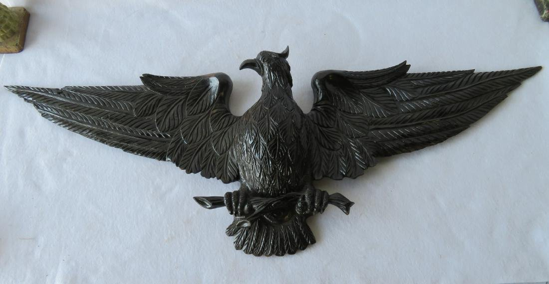 Carved wooden spread wing eagle wall plaque with old