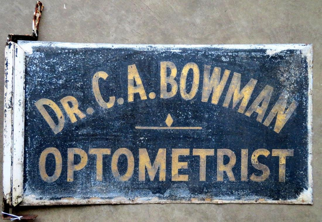 "Three signs for ""Dr. C.A. Bowman - Optometrist"","