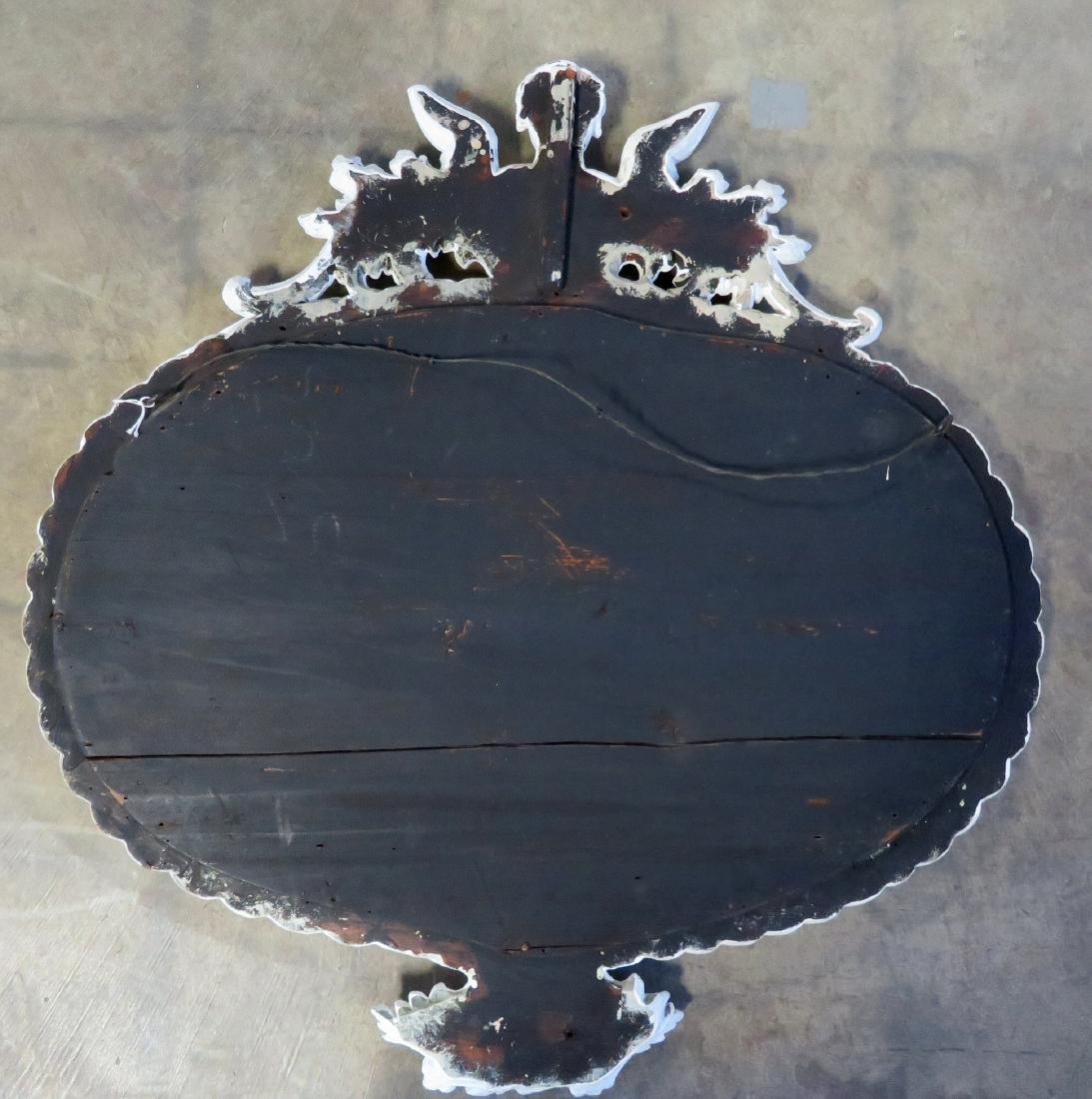 Large oval wall mirror having a double cornucopia, the - 5