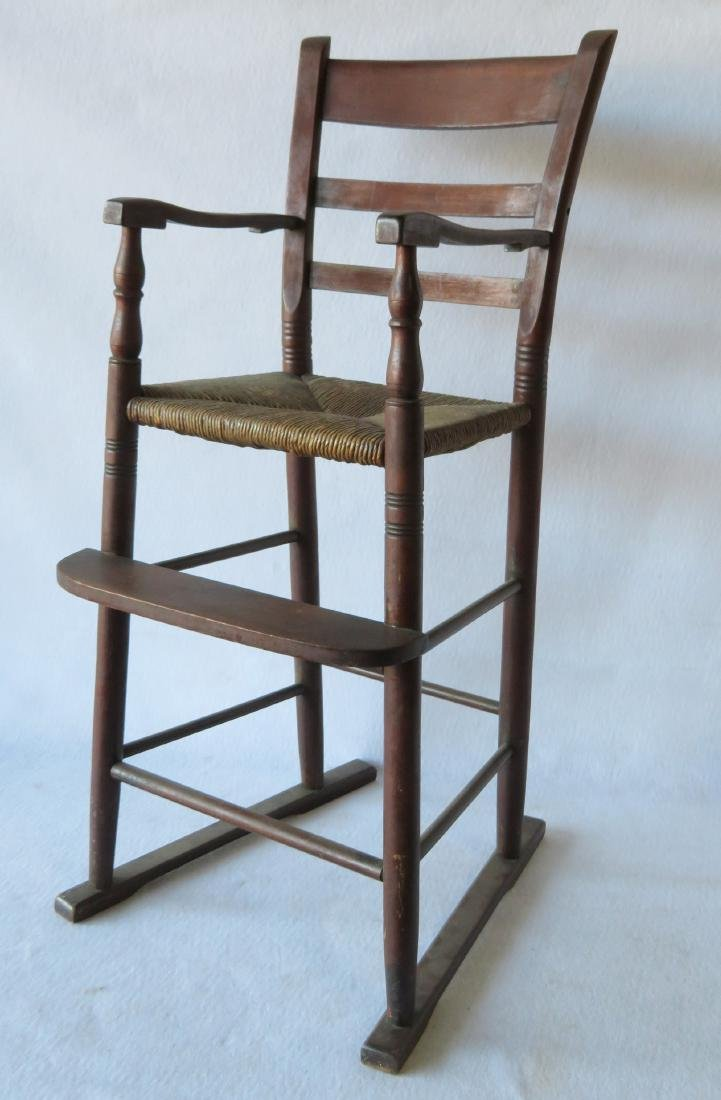 Child's ladder back high chair in original red stain