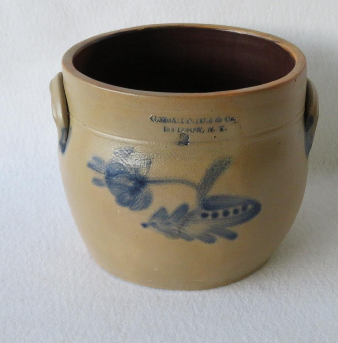 Stoneware 2 gallon crock decorated with a large cobalt