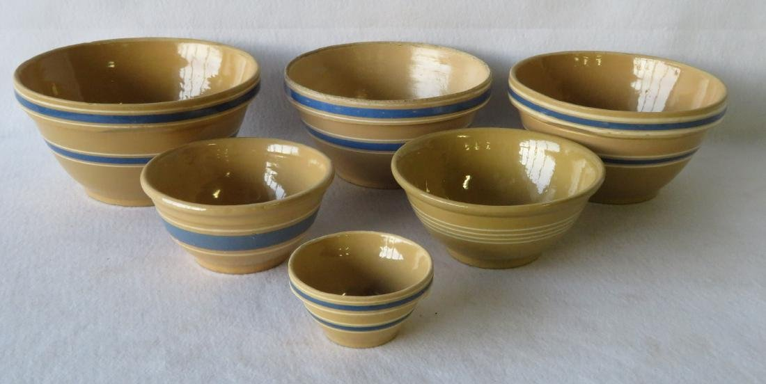 Grouping of 6 yellowware mixing bowls, 5 with blue