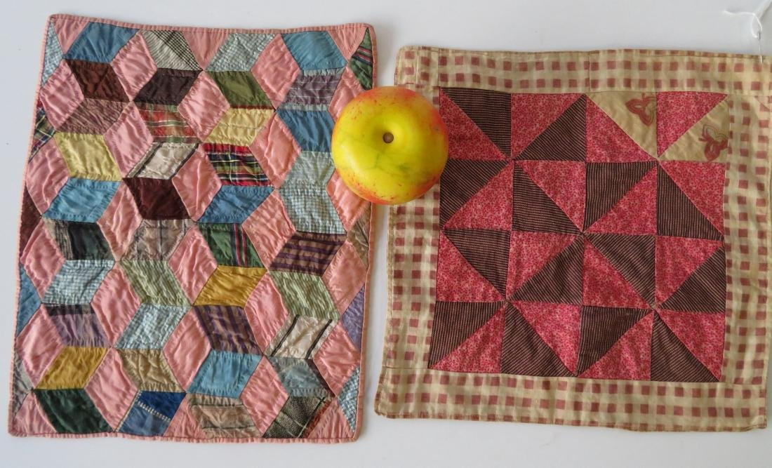Two hand sewn doll's quilts including tumbling block