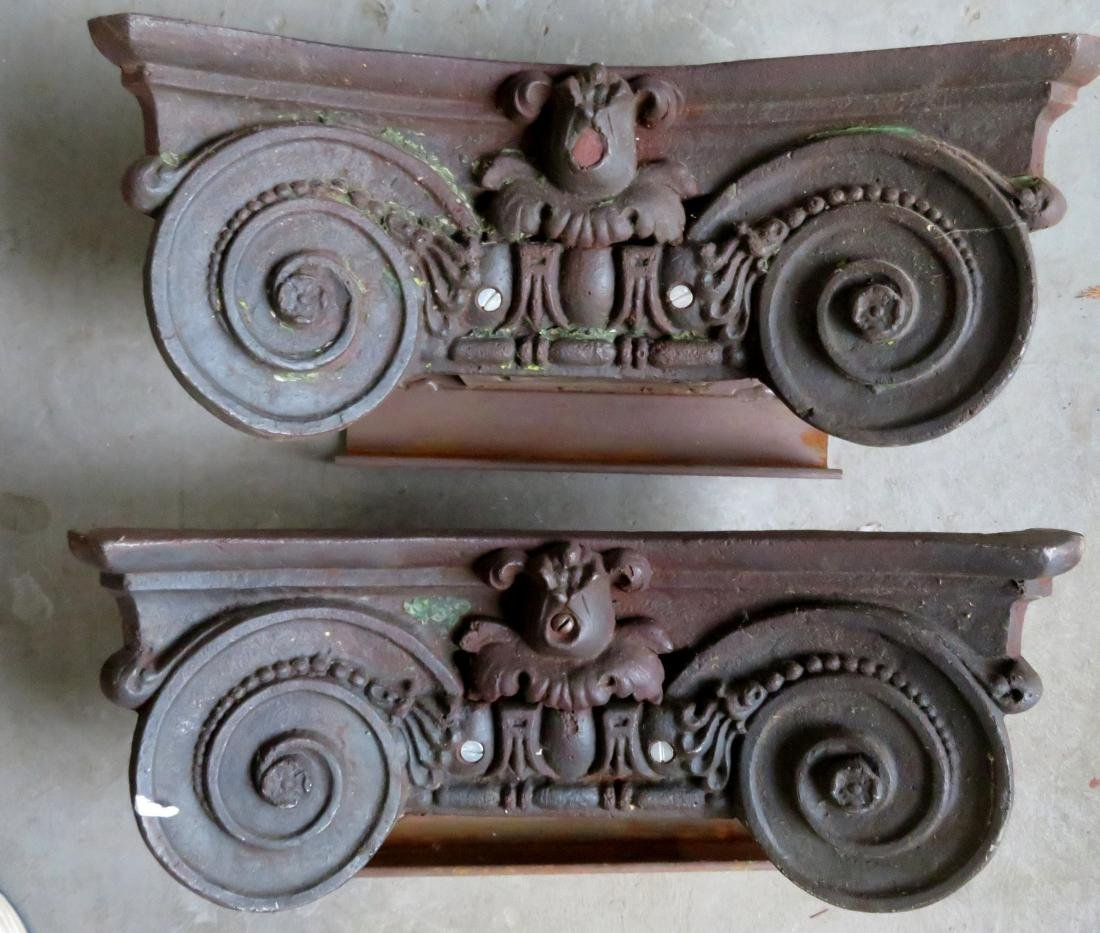A pair of 19th century cast iron building ornaments