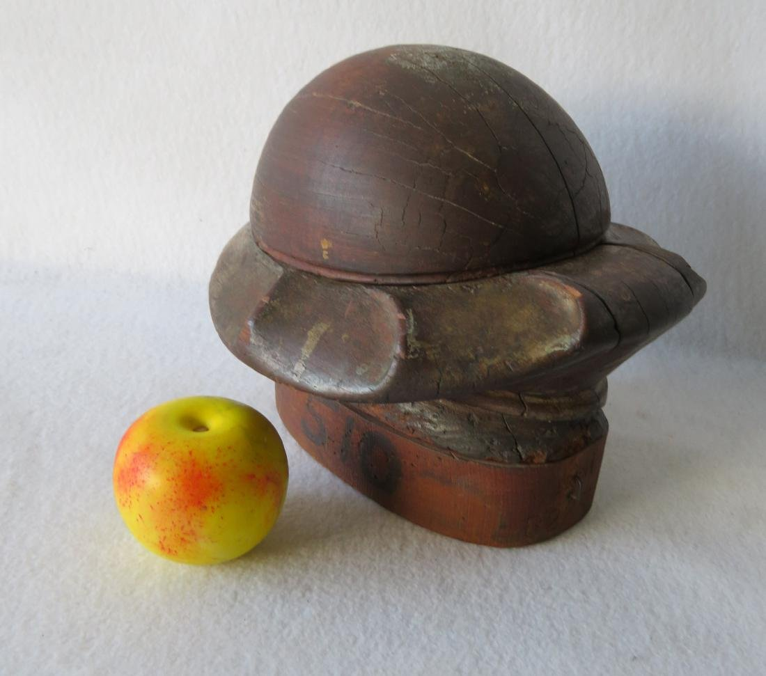Early wooden hat mold composed of removable sections