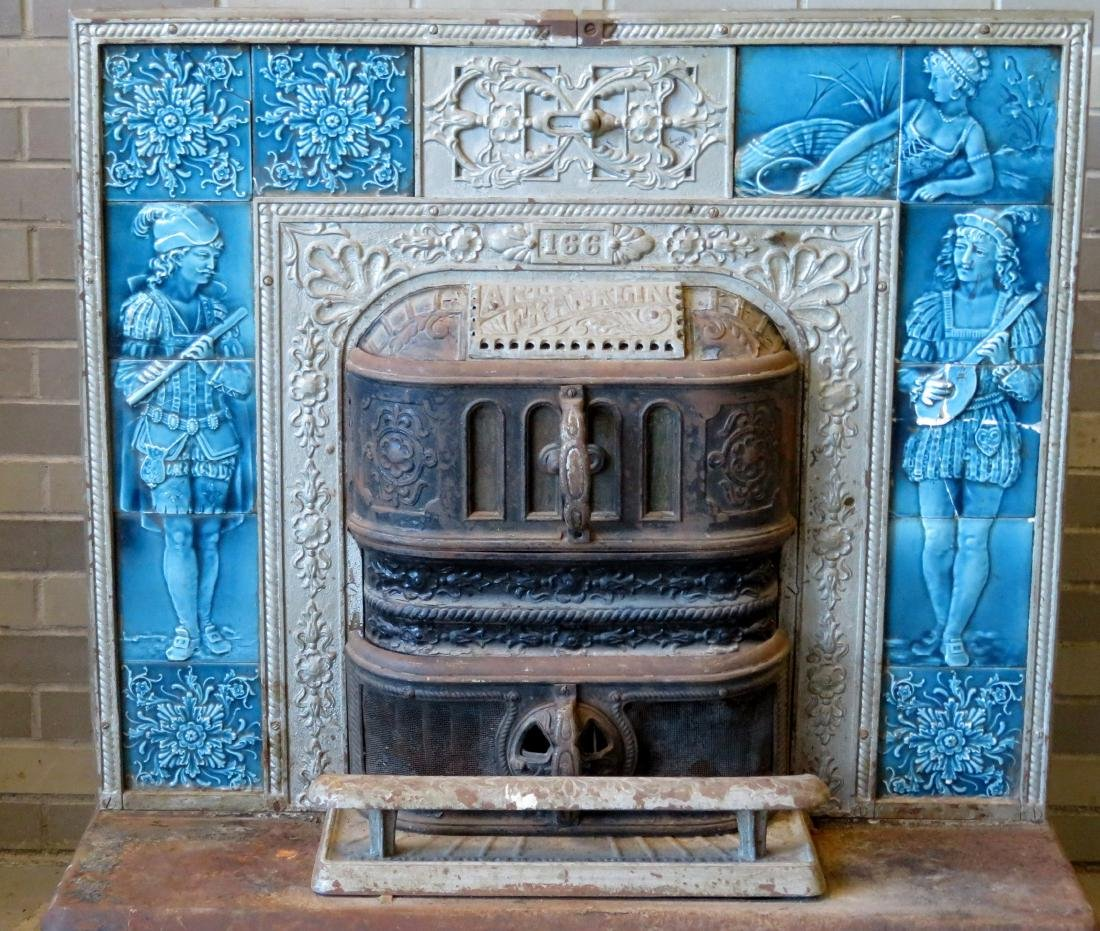 Cast iron stove that inserts into a fireplace with a