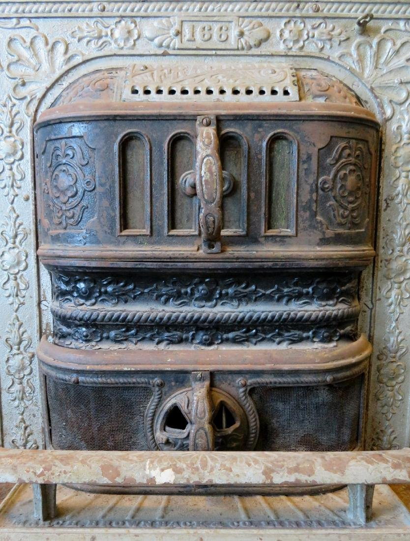 Cast iron stove that inserts into a fireplace with a - 4