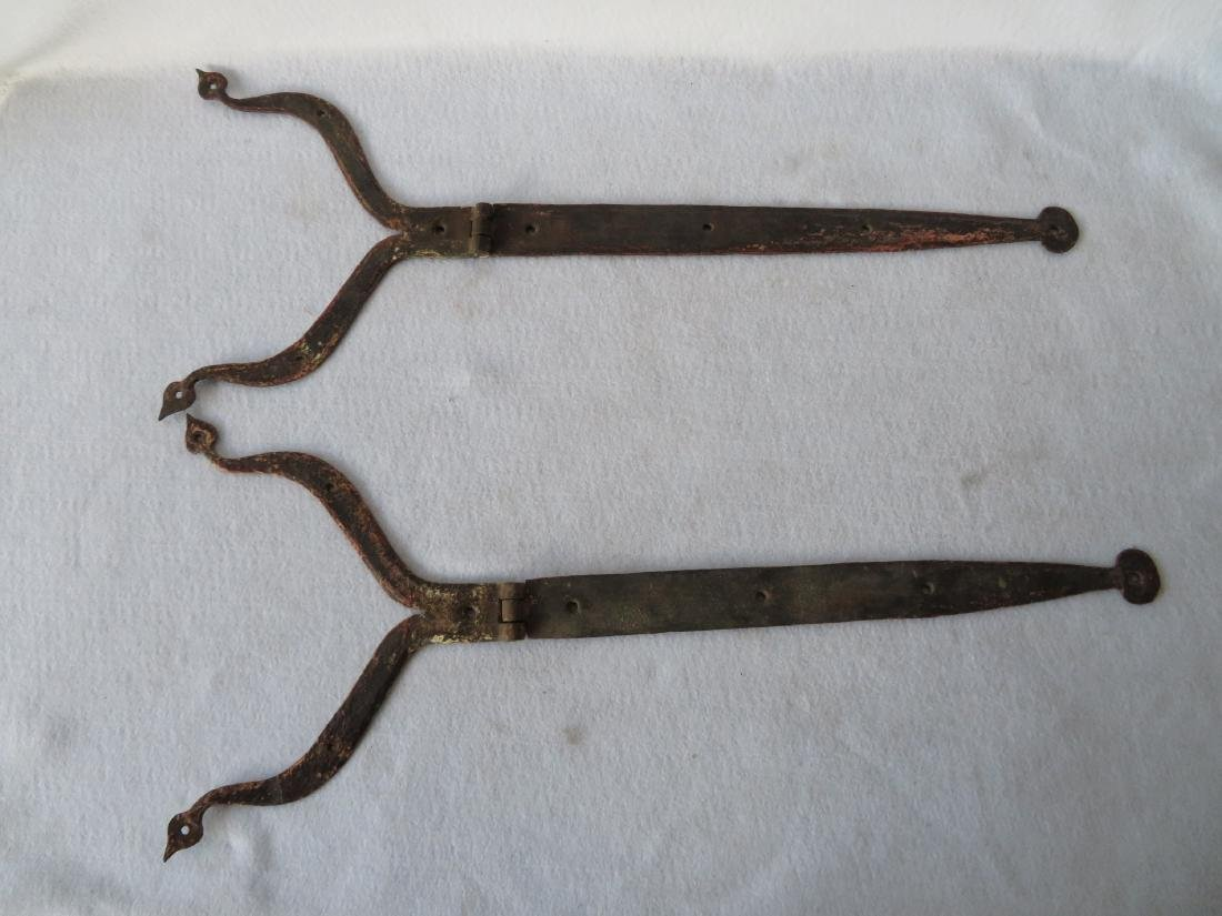 Pair of hand forged iron strap hinge with heart shaped