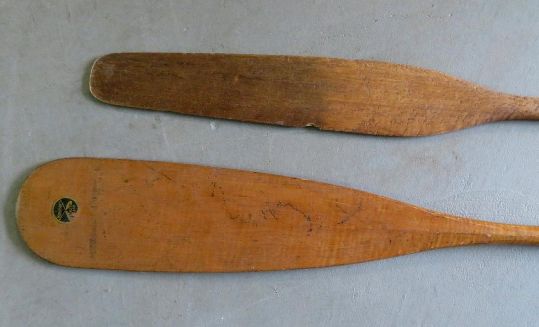 Two carved wooden canoe paddles: 1) Strong birdseye - 2