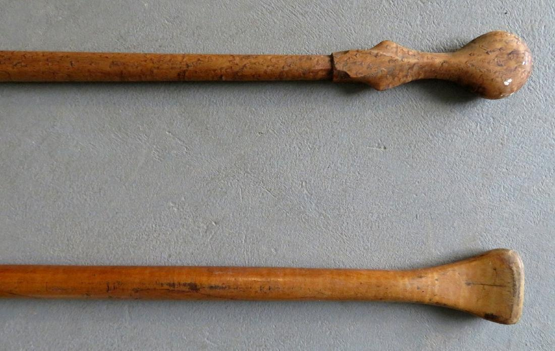 Two carved wooden canoe paddles: 1) Strong birdseye - 4
