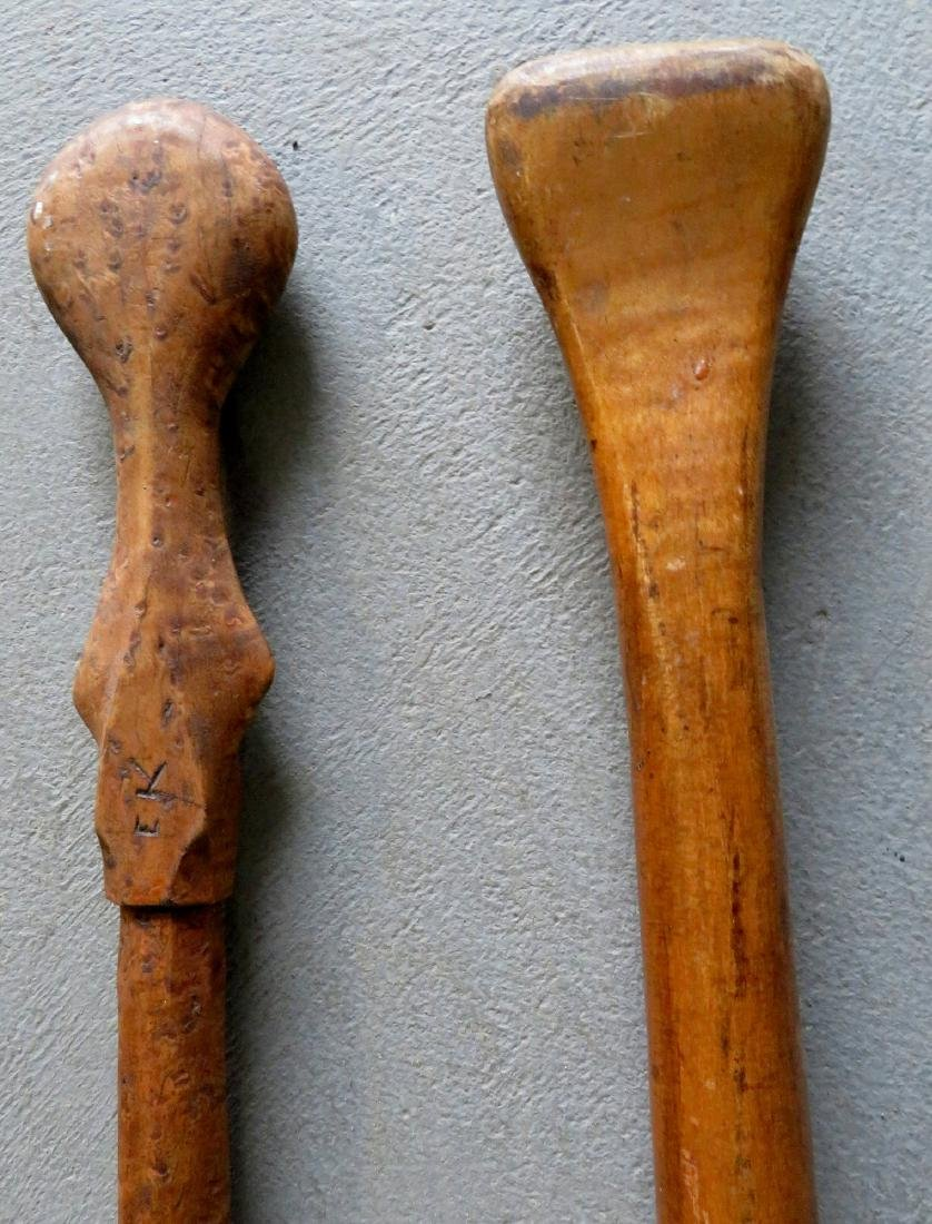 Two carved wooden canoe paddles: 1) Strong birdseye - 5