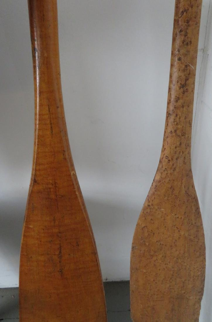 Two carved wooden canoe paddles: 1) Strong birdseye - 6