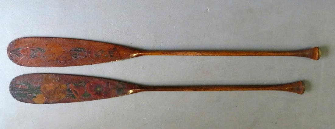 Two carved wooden Flemish art canoe paddles, probably