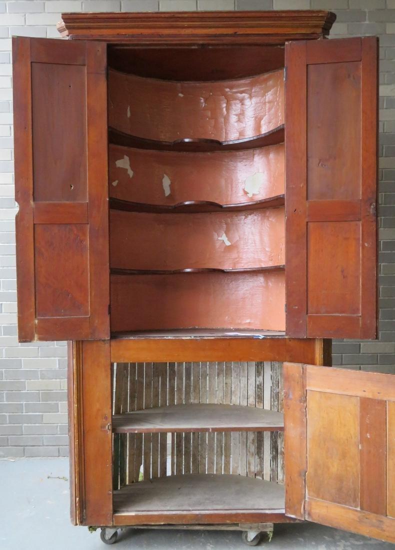 Early barrel back corner cupboard having 2 raised - 4