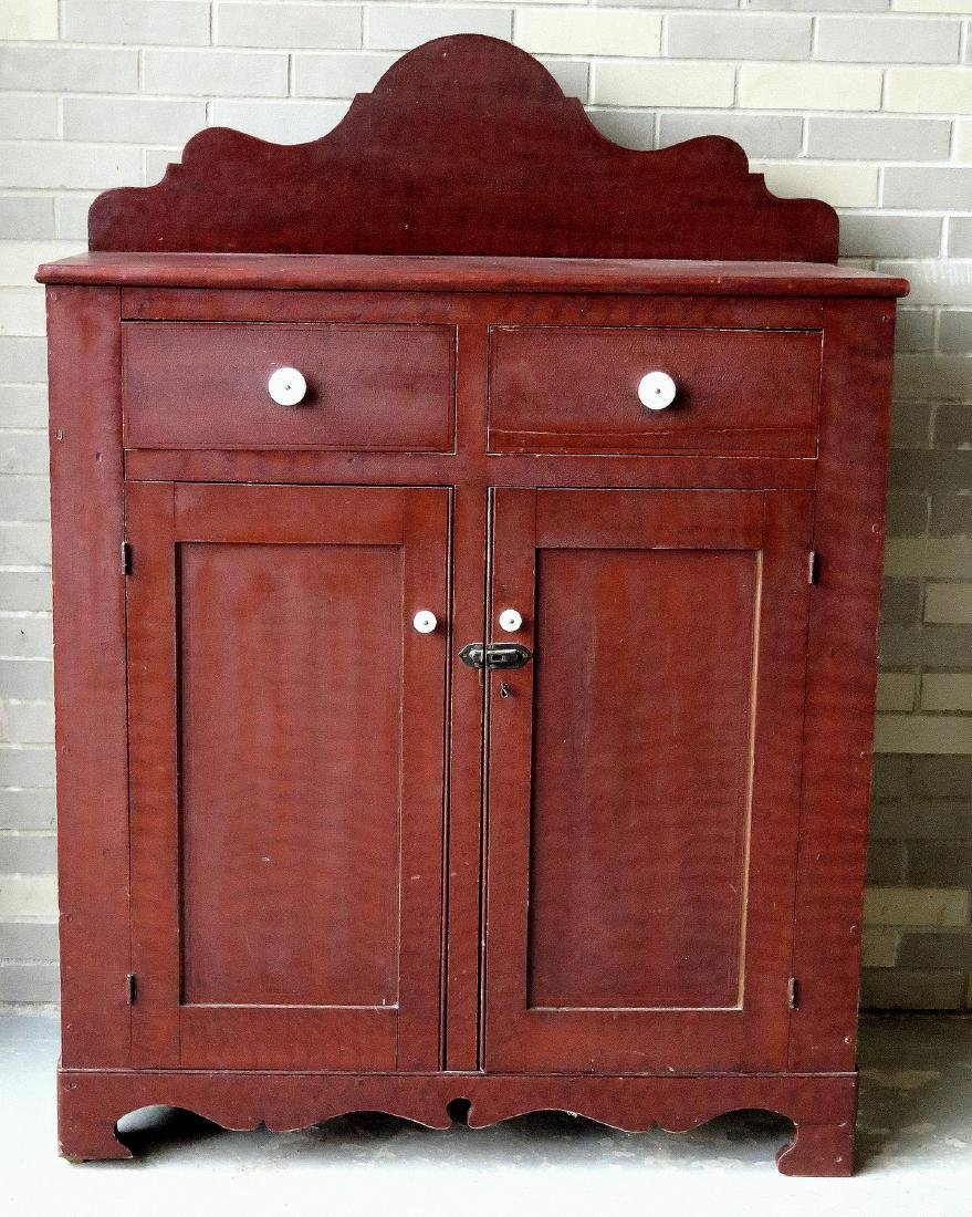 Grain painted jelly cupboard having a shaped