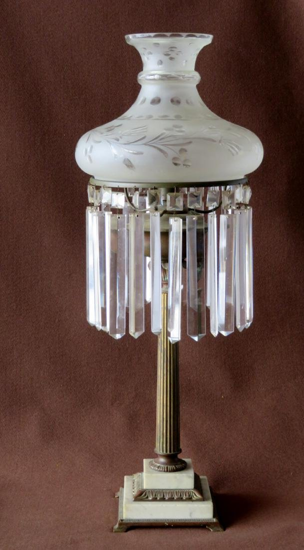 Sinumbra table lamp with architectural brass column