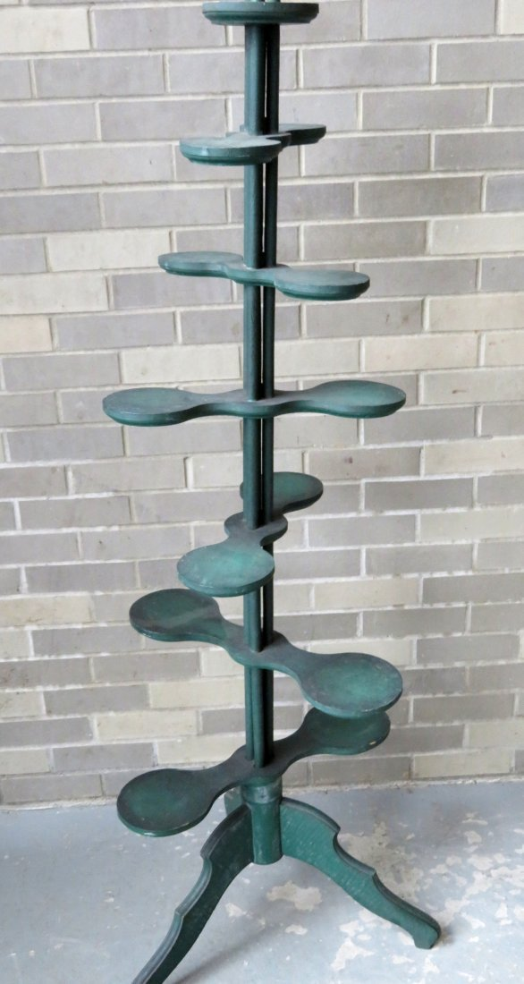 Unusual country store display stand in original green