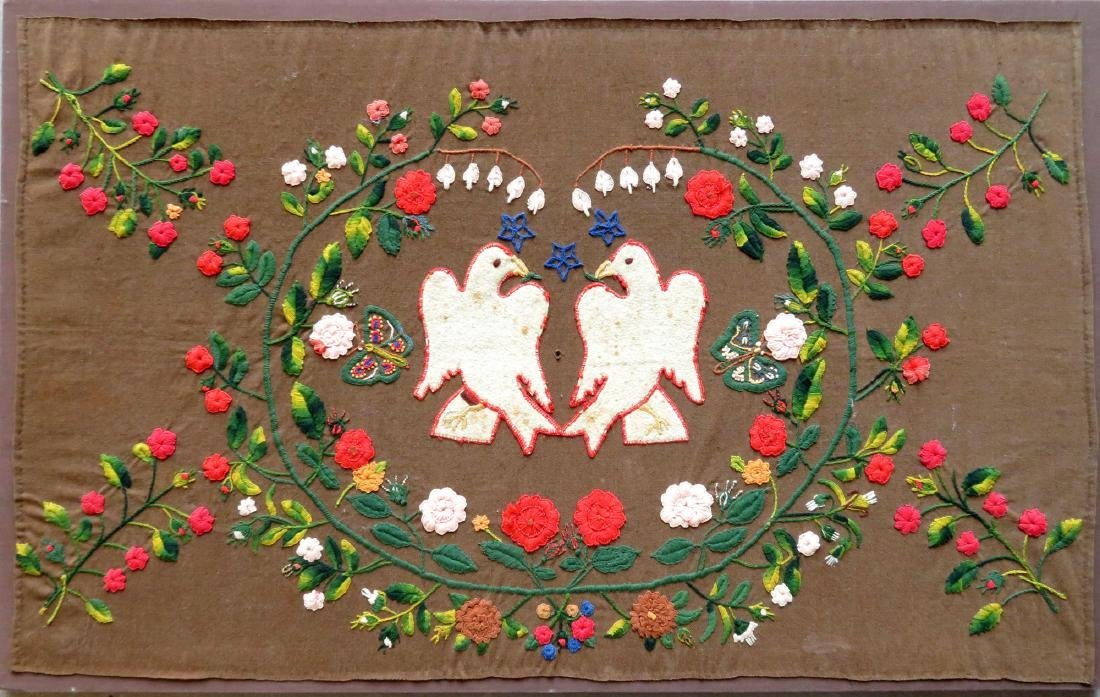 Early mounted embroidery depicting 2 love bird doves