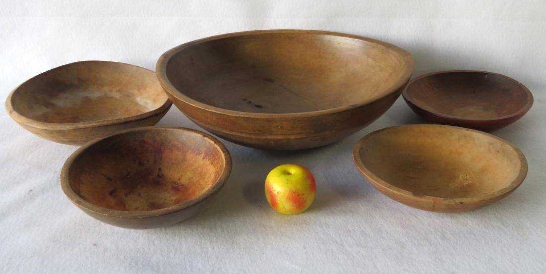 Five primitive turned bowls, 19th century, ranging in