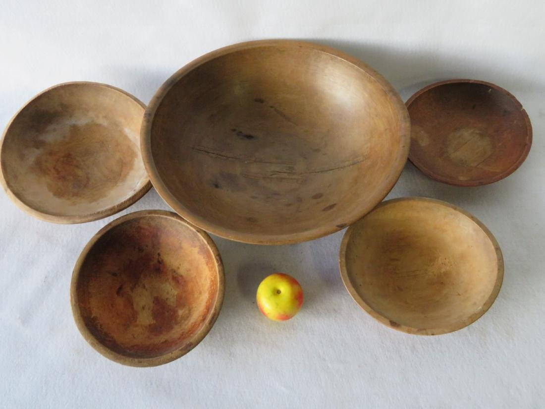 Five primitive turned bowls, 19th century, ranging in - 2