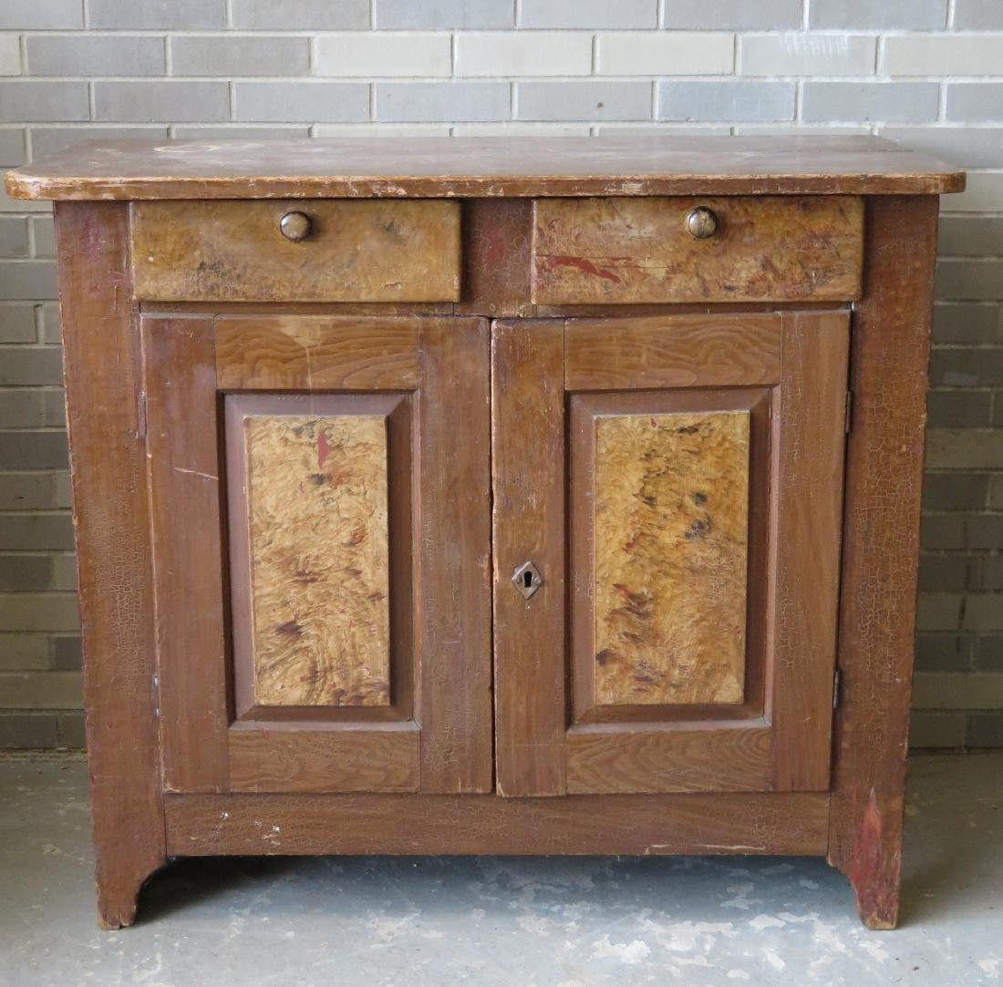 Grain painted cupboard having 2 drawers over 2 paneled